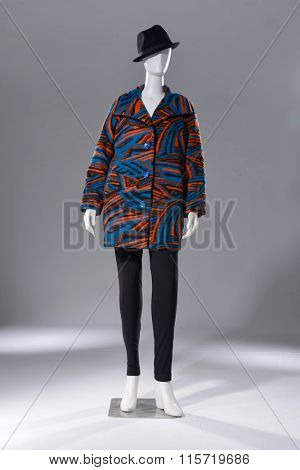 Full length female clothing with hat on mannequin-light background