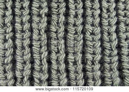 Olive knitted close up background