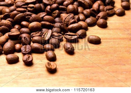 Coffee Beans On Wood Background