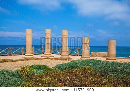 Ancient columns from the Roman period on Mediterranean coast. The scenic part of Caesarea National Park