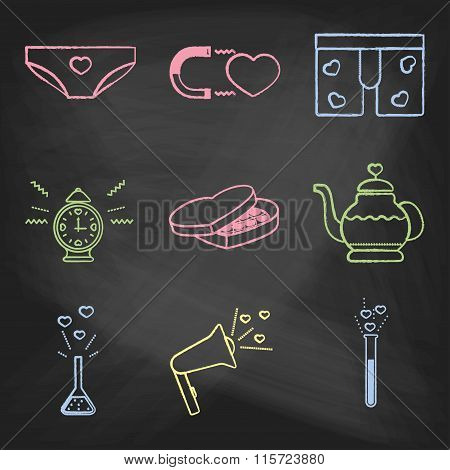 Set of love icons painted with colorful chalk on a blackboard. Decorative icons for Valentine's day.