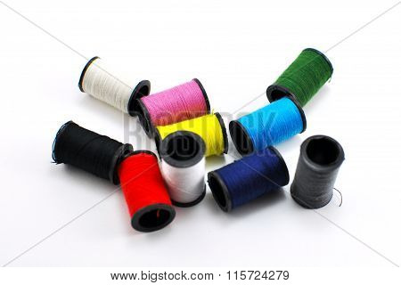 Miniature spools of thread of various colors