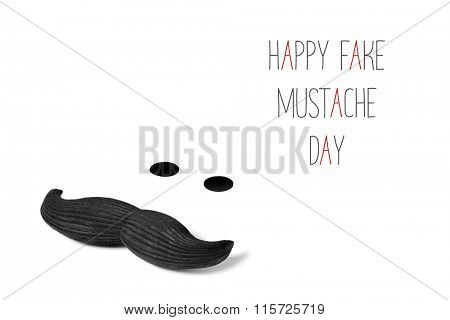 a mustache and two dots simulating eyes, and the text happy fake mustache day in black and red on a white background