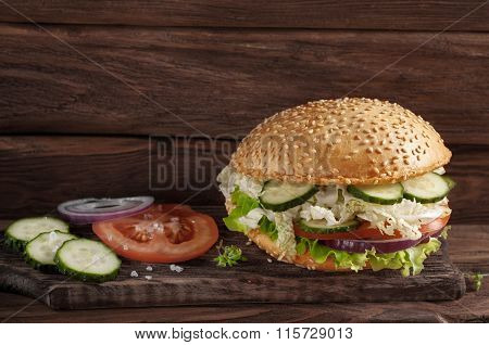 Fresh Veggie Burger On A Dark Rustic Background
