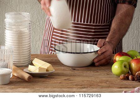 Man Baker Preparing Apple Pie In The Bakery