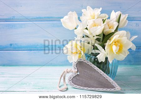 Bright White Daffodils And Tulips  Flowers In Blue Vase And Grey Decorative  Heart
