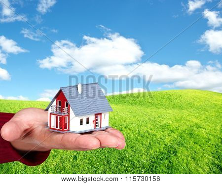 Hand with a little house.