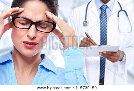 Woman having a migraine headache.