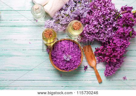 Organic Aroma Oils, Sea Salt,  Lilac Flowers  On Turquoise Painted Wooden Planks.
