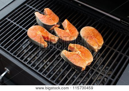 Salmon fish roasted on barbecue grill.