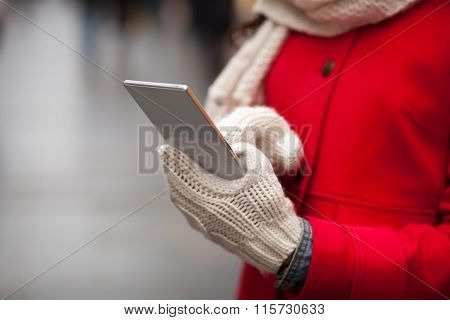 Woman In Wool Gloves Hold Smart-phone