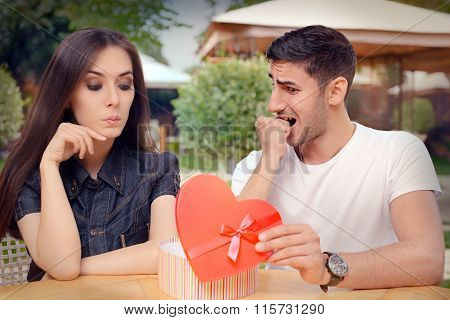 Nervous Boyfriend presenting his Gift to his Picky Girlfriend