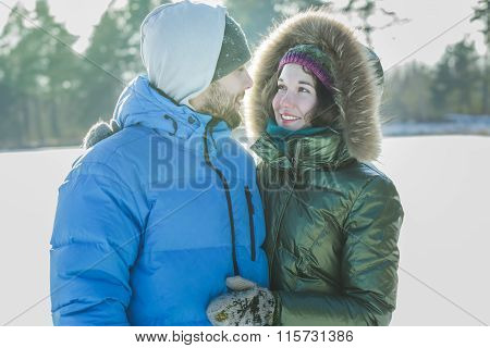 Attractive young people in love looking at each other and smiling