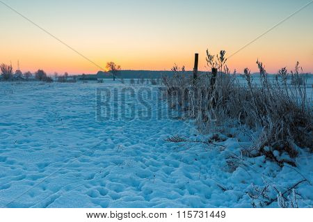 Beautiful Cold Morning On Snowy Winter Countryside.