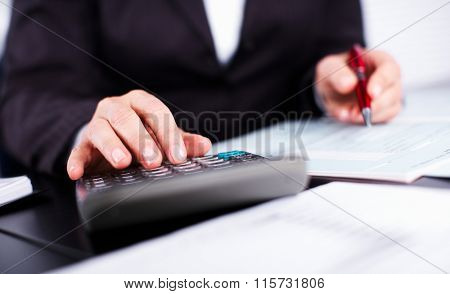Hands of accountant business woman with calculator.