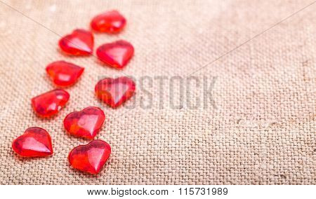 Red Glass Hearts Lie On A Napkin From A Sacking