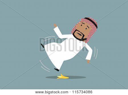 Arabian businessman slipped on a banana peel