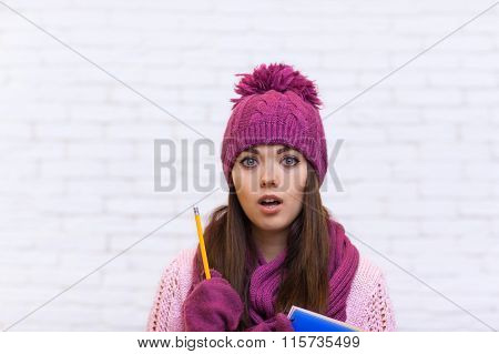 Student Pondering Worried Attractive Girl In Pink Hat Holding Folder Pencil