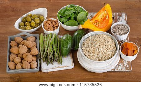 Foods High In Vitamin E On  Wooden Table.