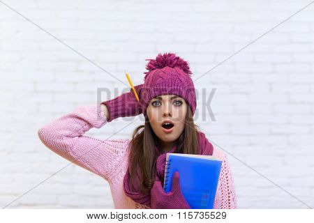 Attractive Stunned Teenage Girl In Pink Hat Student Shocked Holding Folder Pencil