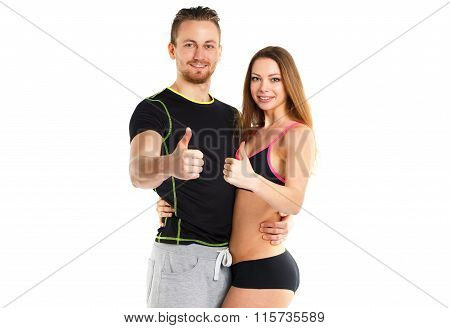 Athletic Man And Woman After Fitness Exercise With Thumb Up On The White
