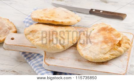 Homemade Pita Bread On  White Wooden Board.