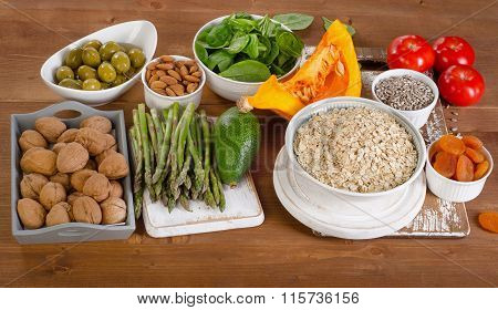 Foods High In Vitamin E On A Wooden Background.