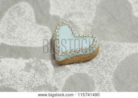 Close-up Of Delicious Cookie With Blue Icing And Edible Beads