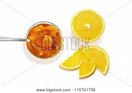 Top View Of Jam With Spoon And Orange Slices