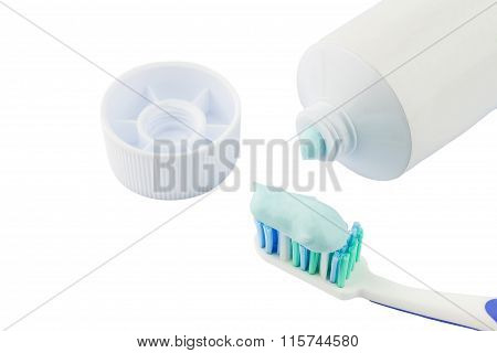 Toothbrush Beside Toothpaste Isolated On White Background.