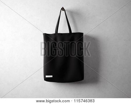 Black cotton textile bag holding, neutral background. Horizontal 3d render