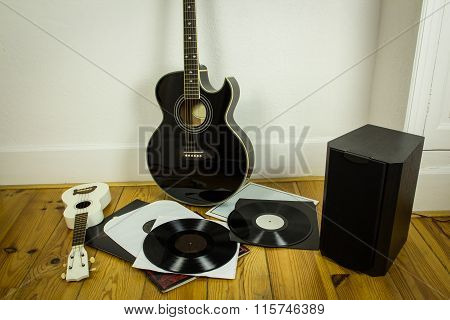 Rock'n'roll Setup With Ukulele, Acoustic Guitar, Speaker And Vinyl Records
