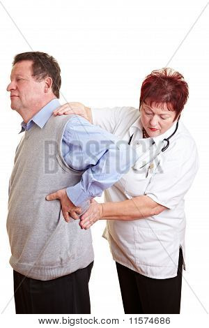 Female Doctor Examing Kidney Problems