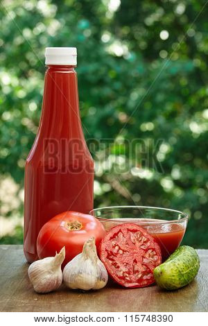 Tomato, garlic, cucumber, hot pepper, bottle of ketchup and juice
