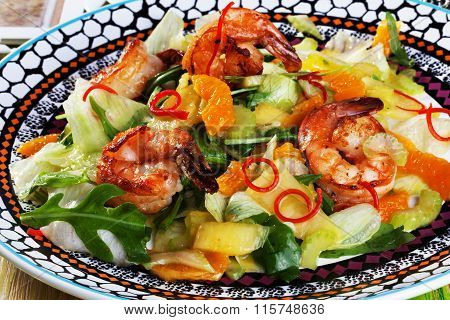arugula salad, mandarin oranges, shrimp still life on the boards of Italian