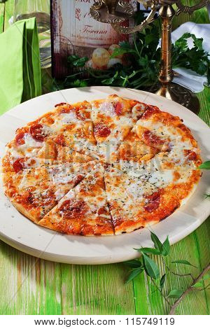 pepperoni pizza in a still life wooden table top appetizing food
