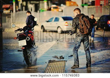 Bike Rider Washing His Motorcycle