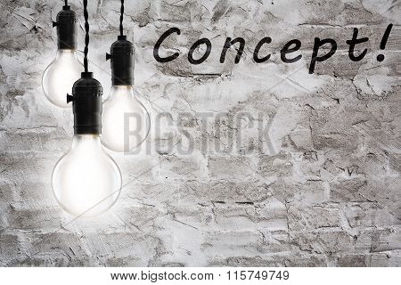 Business Concept - Vintage Incandescent Bulbs On Wall Background