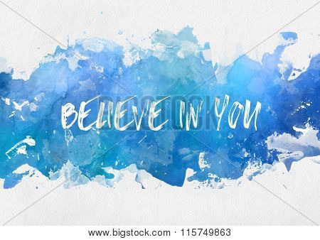 Artistic blue paint splash background with handwritten motivational message - Believe In You - with white copy space above and below