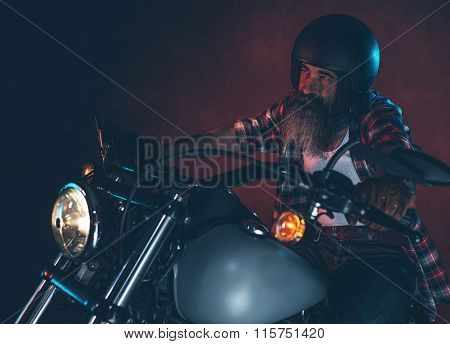 Casual Cool Long Beard Man With Helmet Riding Motorcycle At Night.