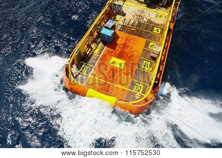 Supply boat transfer cargo to oil and gas industry and moving cargo from the boat to the platform, boat wating transfer cargo and crews between oil and gas platform with the boat.