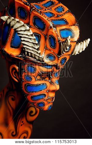 Woman in devil mask