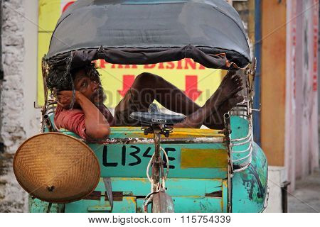 Local  trishaw driver in Yogjyakarta