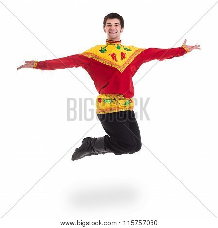 young man wearing a folk russian costume jumping against isolated white with copyspace