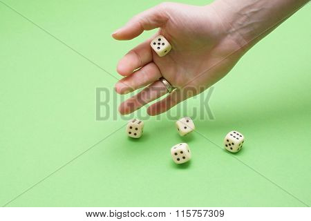 Woman hand and dice