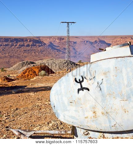Water Tank In   Utility Pole  Land Gray  Metal Weel And Arid