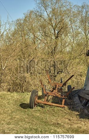 Old broken iron cart with 3 tyres.
