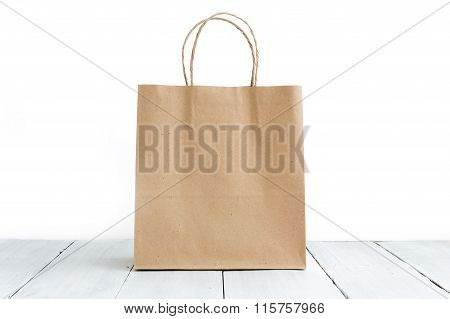 Paper Bag On The Wooden Background