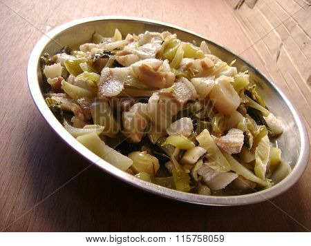 Stir fried sour pickled cabbage with streaky pork