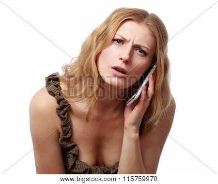 Puzzled , Embarrassed , Mixed Up Woman Talking On The Phone